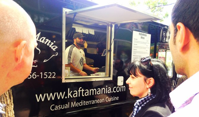 Customer Alioni Dameron waits for her Kafta Classic on the streets of Rosslyn.