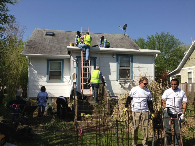 CBRE volunteers make roof repairs and clear out an Alexandria client's backyard as part of National Rebuilding Together Day April 27.