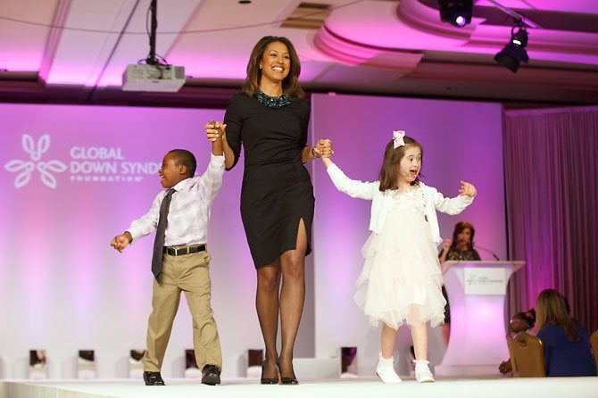 "Julia Anne Greene, 8, a second grader at Waynewood Elementary in Alexandria, shared the runway with Jeremiah Perry of Greenbelt, Md., during the Global Down Syndrome Foundation's ""Be Beautiful Be Yourself Gala"" at the Ritz Carlton in D.C. on May 8. Julia and Jeremiah were accompanied by WUSA anchor Lesli Foster. She loves playing dress up, laughing, playing kick ball, riding her bike and recently starred in the ""Cat-in-the-Hat"" school production."