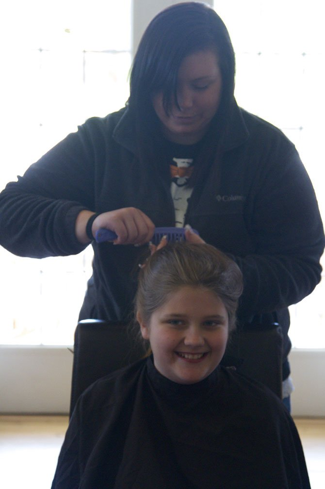 Ashley McGhee, a military spouse, volunteered to shave Sara's and her best friend Ethan's heads.