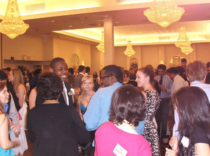 Students have a good time chatting on the dance floor between songs at last week's Day Prom.
