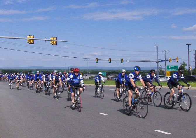 Centreville's Kevin Whalen (in red helmet) helps lead Fairfax County's Police Unity Tour contingent up Route 29, Sunday morning, toward the end of their 230-mile ride.