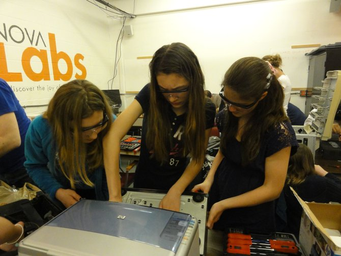 "Megan Palmer, Niu Niu Liken, Elizabeth Shaw work together during Nova Labs' sponsored ""Take-Apart Day."""