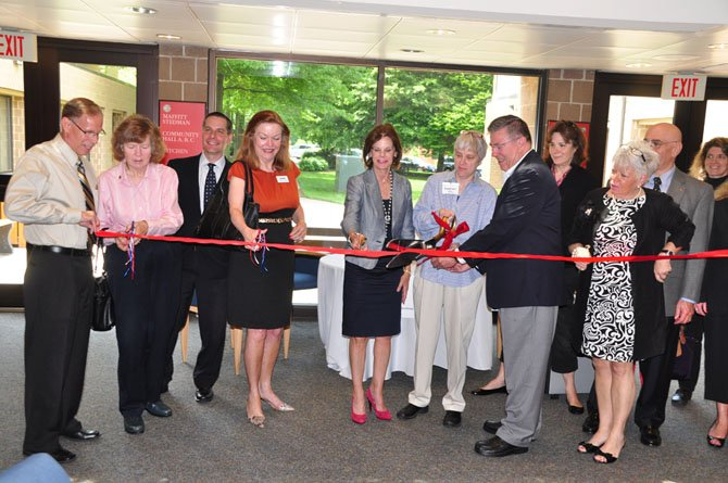 Local officials and volunteers cut the ribbon for the new McLean Senior Source help desk Wednesday, May 15. The service kicked off Tuesday, May 21.