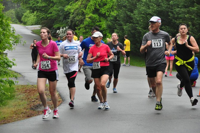 Runners make their way down Columbine Street, the home stretch of the Joe Cassella 5K Sunday, May 19.