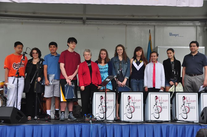 From left, Teen Character Award winners Ben Wang, McLean Citizens Association President Sally Horn, Alex Soltany, William Davis, school board member Janie Strauss, Alex Riddell, Anna Pope, Charlotte Heffelmire, Jade Davis, Azeta Peters and Ben Wiles of Fairfax County. Not pictured are winners Bel Kelly-Russo, Cameron Thompson and Arjan Peters.