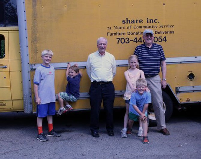 Churchill Road students Whit Walter, Joseph Hoeymans, Kate and Collin Walter helped Steve Mournighan and Vic Kimm load up the SHARE, Inc. truck, with items needed by the food bank.