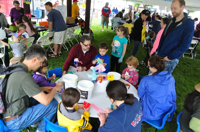 Children create art based on templates from around the world at the Children's Art Tent at the Northern Virginia Fine Arts Festival Sunday, May 19.