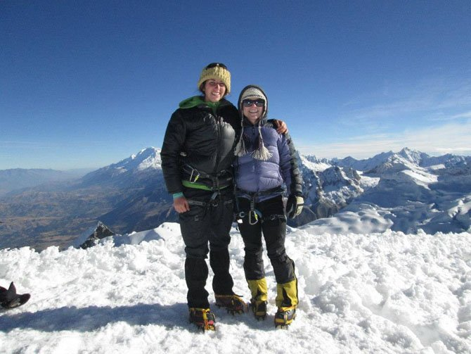 Alison Foley and her sitemate Keren Eyal on top of Vallunaraju, a peak they climbed together.