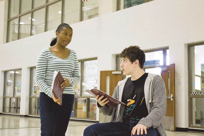 "Binta Barry and Joshua Ewalt rehearse a scene from Centreville High's ""Cabaret."""