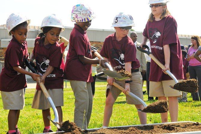 Student representatives from Jefferson-Houston Elementary School perform a groundbreaking in the ceremony for the new school.