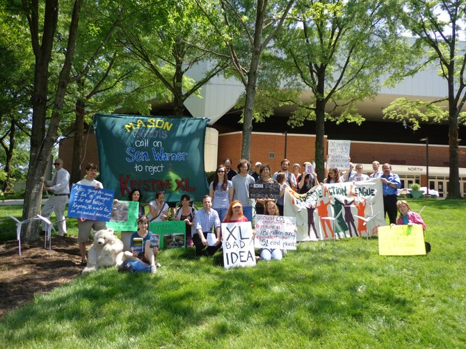 More than 30 GMU protesters rallied Friday, May 17 in advance of Sen. Mark Warner's commencement address to oppose the Keystone XL tar sands pipeline.
