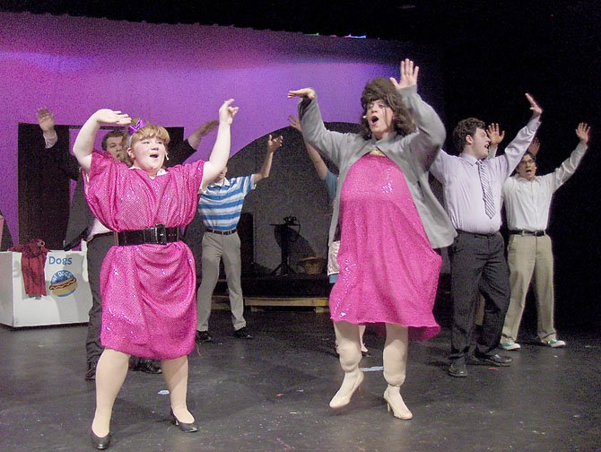 "(From left) Hannah Sikora as Tracy and Jackson Viccora as her mom Edna sing with the cast of ""Hairspray."""
