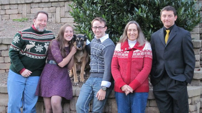 The Stach family (from left) are David, Liesl, dog Frieda, Dieter, Trish and Paetr.