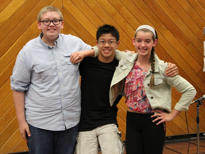 Rocky Run's humorous poetry winners are (from left) Charlie Flynn, first place; Kalvin Yuan, second; and Sydney Suarez, third.