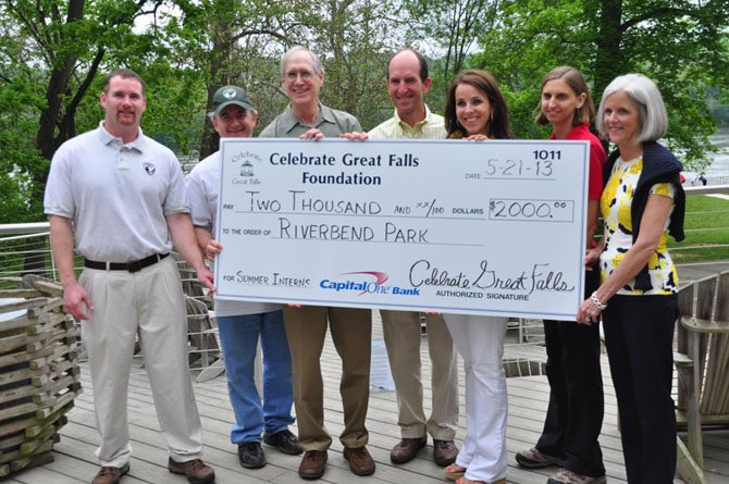 Members of the Riverbend Park Staff and the Friends of Riverbend Park receive a check for $2,000 from Celebrate Great Falls, which will pay for a summer intern. The Friends of Riverbend Park donated $10,000 for this summer, to pay for five interns.