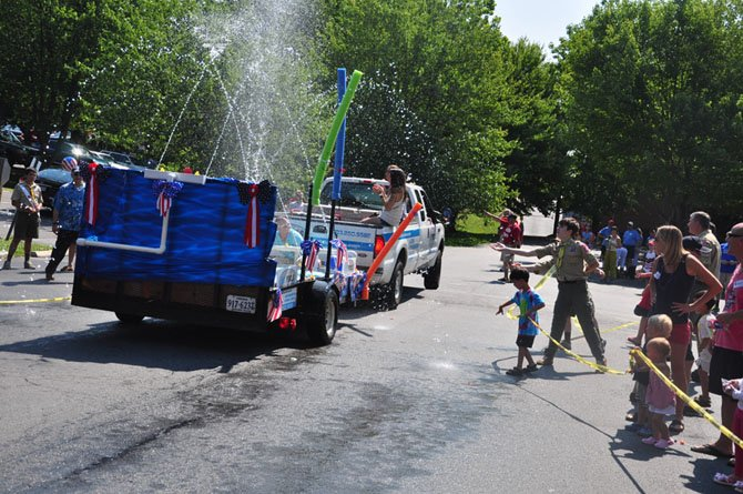 The H20 pools float cools down parade spectators during the annual Great Falls Fourth of July parade last year.