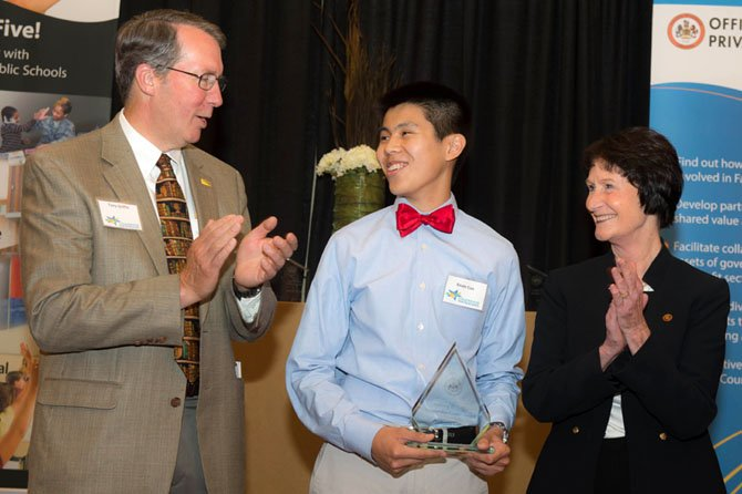 Kevin Cao, a senior at Thomas Jefferson High School, receives the Tony Griffin Partnership Leader award at the 2013 Celebrate Partnerships Award Ceremony on May 21 at the Mason Inn and Conference Center. Former County Executive Tony Griffin and Sharon Bulova, chairman of the Fairfax County Board of Supervisors, applaud Cao's initiative in co-founding GIVE, Growth and Inspiration through Volunteering and Education, a tutoring program.