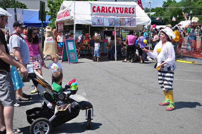 Wandering live acts, including clowns and a monkey trainer, will be around the Herndon Festival this year, which starts Thursday, May 30.