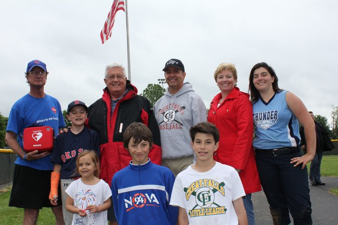 Pictured in front are Great Falls Little League Players, while in back, from left, are Jim Seymour, Jackson Emery and Nat Emery of the Seymour Foundation with Mike Cerrantani, Michelle Gasparis and Caroline Gasparis of the Great Falls Little League.