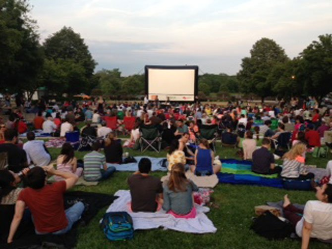 People attending the Rosslyn Outdoor Film Festival.