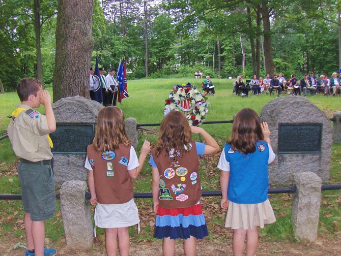 Scouts salute the monuments of Generals Isaac Stevens and Philip Kearny in Ox Hill Battlefield Park.
