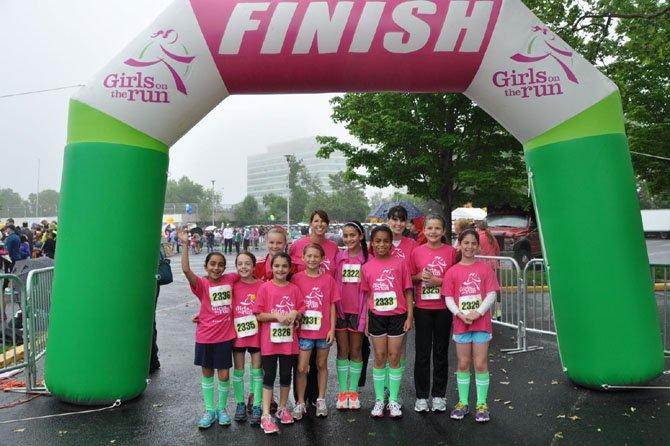 Girls on the Run: Back row, Carly Casten, Deb Muniz, Wysh Anstine, Melissa Kupferschmid, Samantha Dainty, front row, Artina Zarpak, Lizzie Baggett, Lilt Keshishian, Julia Muniz, Amanda Oliver And Jenna Kupferschmid.