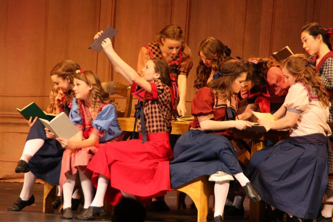 "South County High School's cast of ""The Music Man"" performs. Actors are, from left, Lindsey Otto, Marin Tettelbach, Katelyn Sparks, Rachel Epstein and Samantha Hamilton; and, back row, from left, Darby Glackin, Emmy Brien, Kelsey Davis and Kathy Oh."