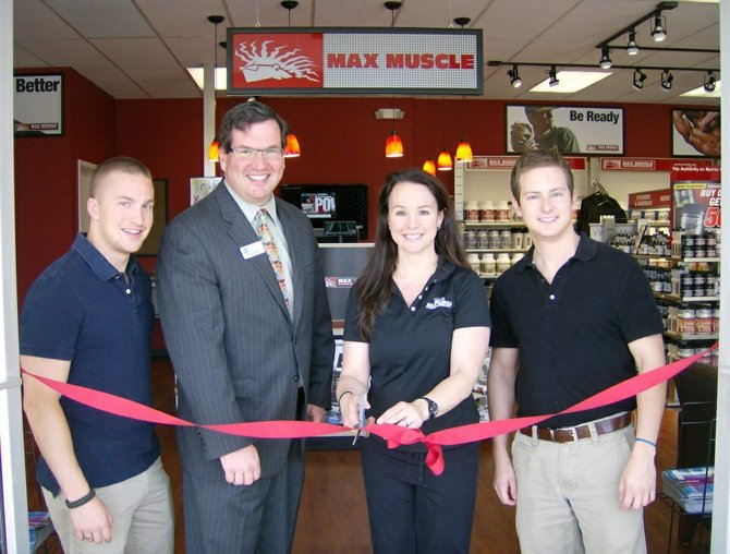 Employee Mike Landers, Greater Springfield Chamber of Commerce President Michael Drobins, Corry Matthews, owner of Max Muscle Manassas and Springfield, and Nick Andrews of GM for Max Muscle, Springfield.