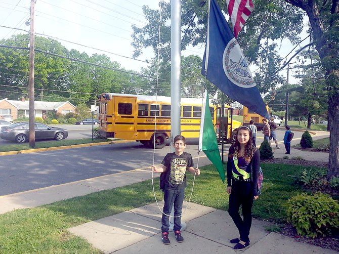 Raul Rodrigez and Michelle Rodrigez, students at Lynbrook Elementary, hang air quality flags as part of the U.S. Environmental Protection Agency's School Flag Program, which help teachers and students know what the air quality is expected to be daily. The school is the first in the county to adopt the program.