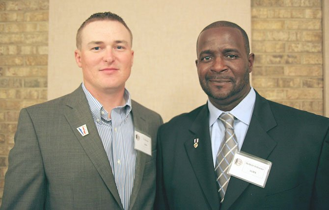 Retired Marine Sgt. T.J. Brooks and retired Army Sgt. DeWitt Osborne are Wounded Warriors who have benefited from the golf program at Ft. Belvoir.