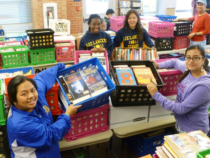 Members of the Lee High School Tennis Team unloaded hundreds of crates of books for the Richard Byrd Mystery Book Sale beginning Thursday, May 30.
