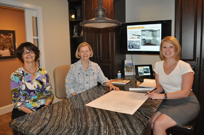 Connie Sorrentino, 70, (center) reviews plans to introduce aging-in-place innovations into her kitchen and several bathrooms with Sun Design Remodeling's Mindy Mitchell (left) and designer Kim Kruskamp.