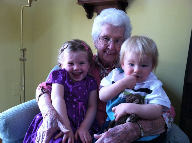 Dot Brown, 96, holds two of her great-grandchildren, Harper and Eamon. Mental health experts say that strong familial relationships contribute to one's overall sense of well-being.