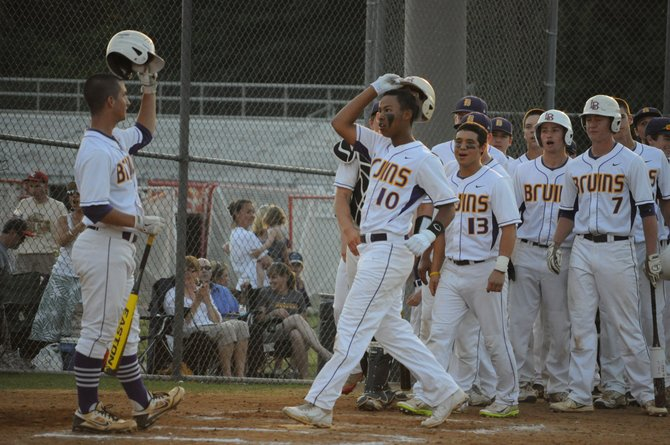 Lake Braddock third baseman Alex Lewis (10) is greeted at home plate by Thomas Rogers after hitting a solo home run against Marshall on Wednesday in the Northern Region semifinals.