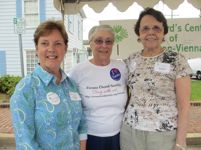 Casey Tarr, Kathy Tugendhat and Jean Bastien, volunteers at the Shepherd Center of Oakton-Vienna, man the SCOV tent at ViVa! Vienna! over Memorial Day weekend.