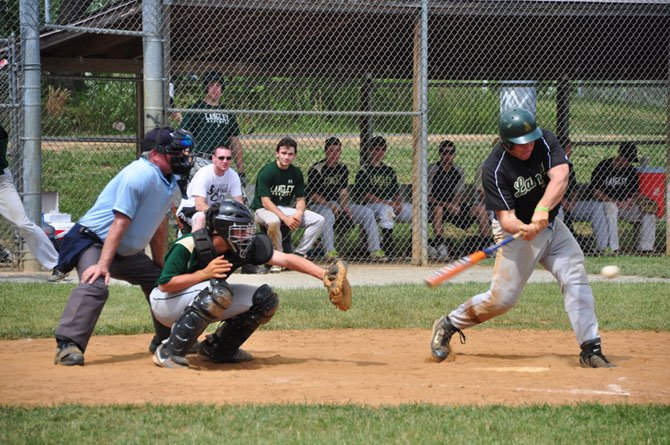 Eddie Gonzalez, playing for the Langley Alumni team, bats against the Langley varsity Sunday, June 2. Gonzalez hit a two-run home run in the alumni team's 11-2 win.