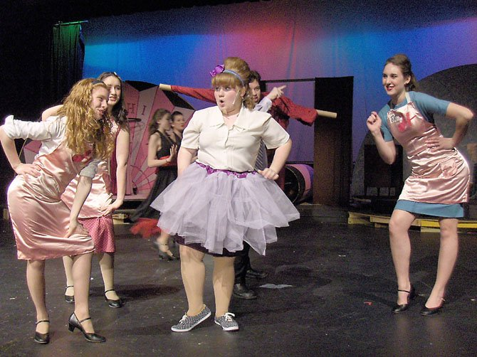 "From left) Rachel Ingle, Mady Hanton, Hannah Sikora and Katie Mahon-Kuzin rehearse a number from Robinson's ""Hairspray."""