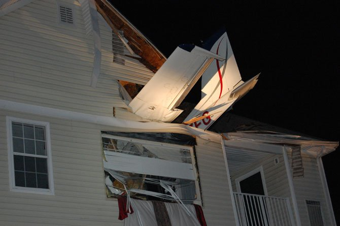 The nose of the plane came to rest on the living room floor of a third-story apartment.