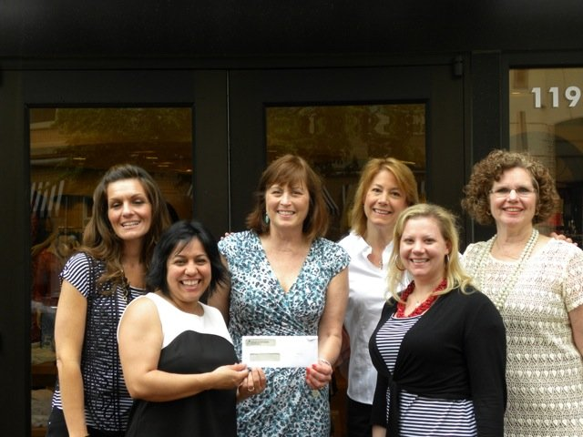 Pictured, from left: Jess Arch of Chico's Reston, Laly Goodmote, director of Artemis House, Karen Ryan, Marti Campo, Michelle Bowles of Chico's Reston, and Renie Langan, OLGC Women's Club president.