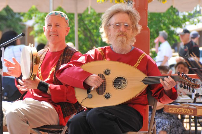 Ken Wright plays the Oud as Marakesh accompanies on a traditional percussion instrument while the Hyetones perform at the festival.