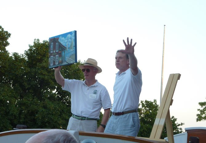 Seaport Foundation managing director Tom Tuttle and John Kreutzer auction off a painting by ASF apprentice Anthony Ness during the Wine on the Water fundraiser June 1.