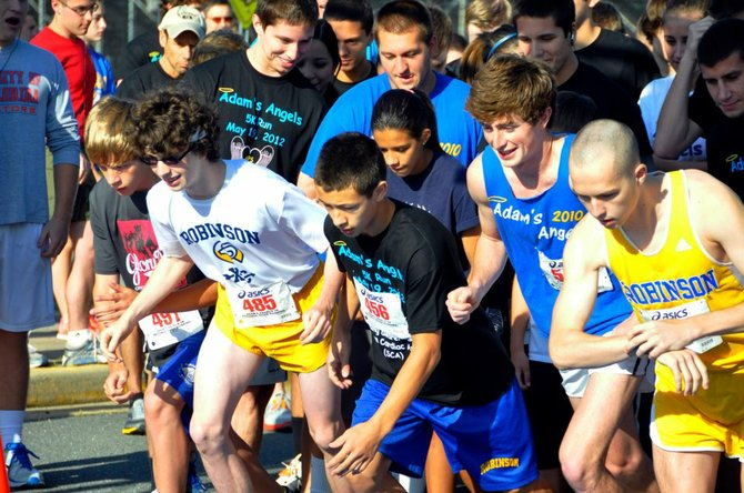 Runners take off from the startling line of last year's Adam's Angels 5K race.
