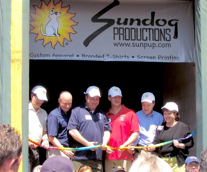 Founder CAS Shiver leading a ribbon cutting for Sundog's grand opening on Jermantown.