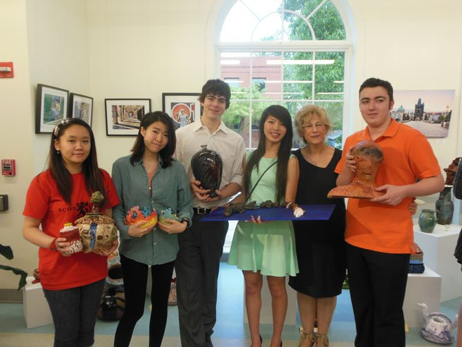 Holding their creations, Centreville High artists at the Clay Connection awards ceremony are (from left) Stephanie Truong, Jiyae Han, Jordan Axelrod, Mary Do, teacher Rory Marcaccio Schaffer and Christian Hall.