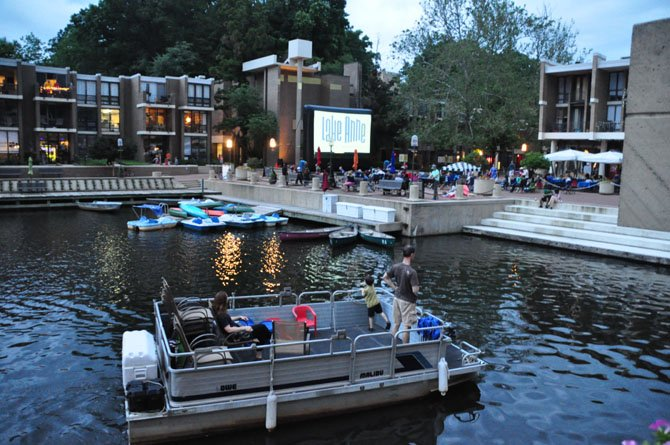 "Boats pull up to Lake Anne Plaza to watch ""Back to the Future,"" the first film in the Lake Anne summer film series Sunday, June 9."