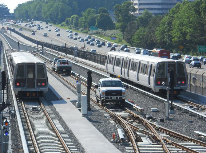 WMATA cars continue testing all along the Phase 1 alignment from East Falls Church to Wiehle Avenue in Reston. In this photo, cars are being positioned on the trail tracks for testing (west of the Wiehle-Reston East Metrorail Station) before being temporarily stored.