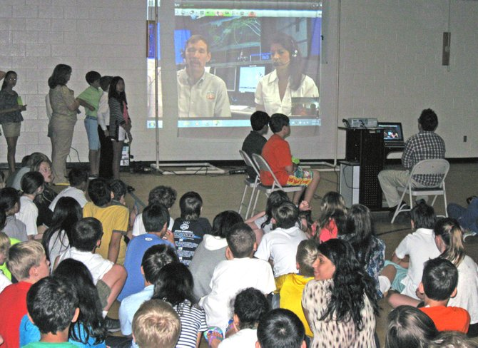 The children communicated with NASA's Mission Control via a live broadcast televised on NASA TV.