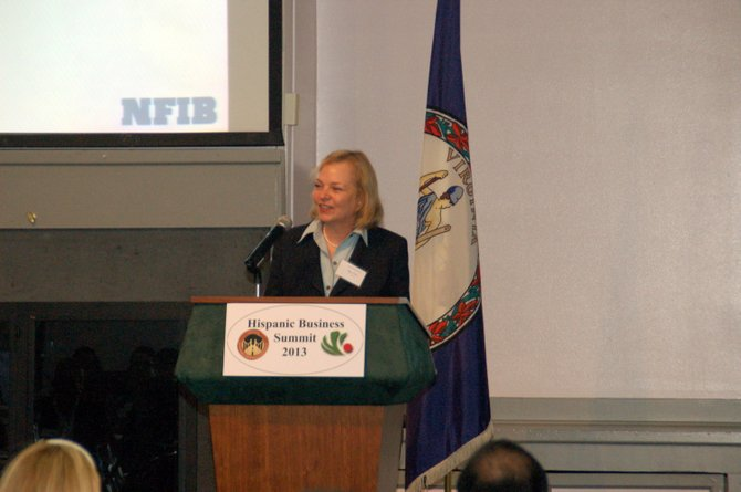 Margery Leveen Sher speaks to business leaders at the Hispanic Business Summit.