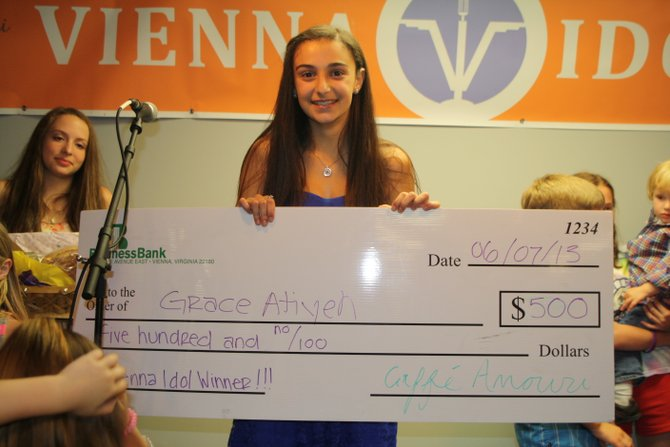 "2013 Vienna Idol Grace Atiyeh accepts her $500 prize. She sang ""Somewhere Over the Rainbow"" to advance to the final round where she sang ""I Will Always Love You."""